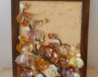 Flowers, box of shells and stones, installation art, materials and colors natural