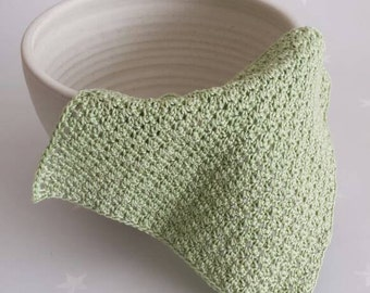 Exfoliating face cloth, A crochet cotton facecloth in pale green, vegan friendly wash cloth
