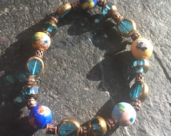 Teal glass and ceramic floral beaded stretchy bracelet