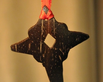 Unique hanging Christmas Bethlehem star carved individually from coconut shell