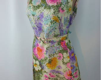 60s Floral Shift Dress. Cream with pink green purple yellow flowers. Belted. Zipper Closure. Size M.