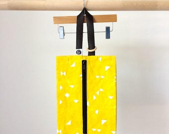 Yellow waxed canvas nappy bag made with organic cotton dyed naturally , leather handle with teething ring