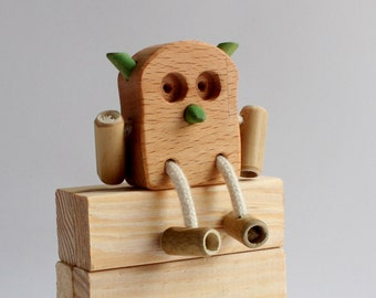 OWL in wood and bamboo harvested locally with ecological oil finish
