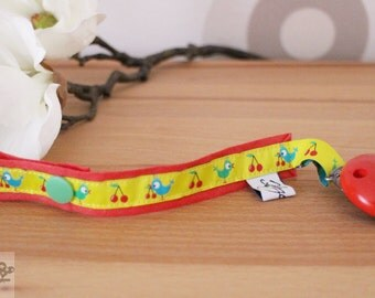 Pacifier pacifier Ribbon bird cherry red yellow