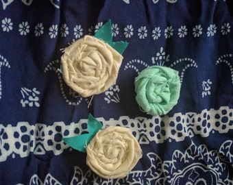 Fabric rosette magnets