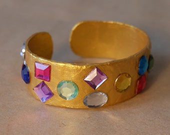 Gold paper mache cuff with rhinestones, bling statement bracelet, shiny carnival jewelry