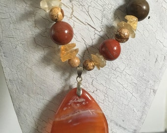 Semi precious amber coloured pendant
