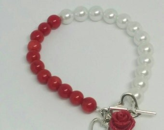 Red and White Beaded Bracelet with Red Rose and Heart Charms