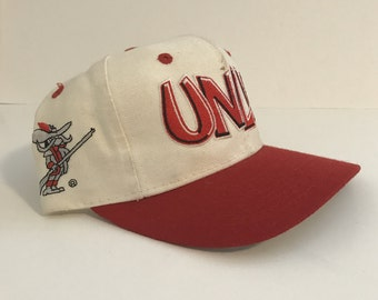 Vintage UNLV Rebels Snapback made by Top Of The World TOW -- In good condition -- Rare -- Script -- NCAA