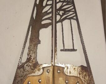 Handsaws tree swing artwork