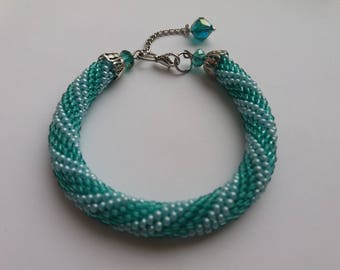 Knitted crochet bead tourniquet-bracelet on the arm