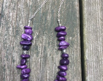 Purple beaded necklace with attached chain