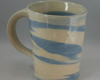 Blue and white handmade agateware mug