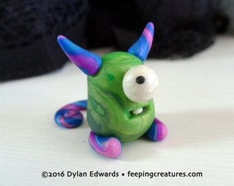 Green and Pink Horned Blob Monster - Feeping Creatures monster figurine