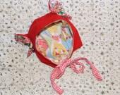 red wool bear helmet with silver jingle bells