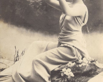 Lutece plays the Aulos. French Postcard by Reutlinger, posted 1902