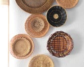 "RESERVED // vintage set of 12 straw rattan wall baskets | black and large 17"" wall basket"