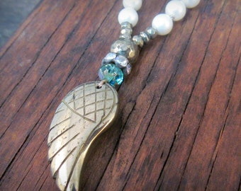 Hand Knotted Necklace with carved pyrite wing bead pendant, Creamy pearls, ocean shades of blue Czech Glass Beads