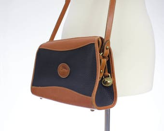Vintage 1980s Black and British tan Vintage Dooney and Bourke Crossbody Purse/ pebbled leather bag/ all weather leather satchel/ made in USA