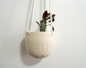 White on white geometric carved ceramic hanging planter