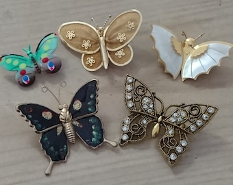 Five vintage butterfly brooches