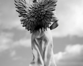 Artistic photography of an angel statue, black and white, timeless, angel wings, angelic, cemetery.