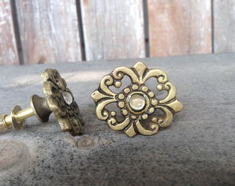 Small antique brass finish drawer pull knob with glass center
