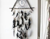 Mystic Night . dreamcatcher triangle in wood, with quartz point, feathers, agate and bones for pagan and witchcraft decoration .