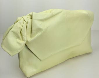 pale lemon yellow oversized leather clutch 80s