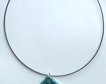 earrings and necklace with blue crystalline ceramic pendant