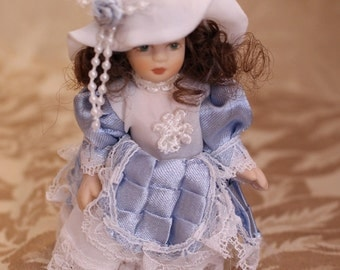 Victorian Doll Blue Dress Porcelain Face, Arms and legs. Blue and White