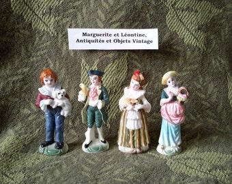 Set of four (4) figurines of porcelain bisque, Victorian characters.