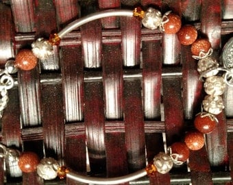 Bali and Sterling Silver Charm Bracelet with burnt orange crystals and sparkled beads. Tree of Life Charm.