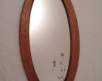 "Vintage Oval Oak Mirror with Gold Hummingbird Flower Detail 21x11"" overall"