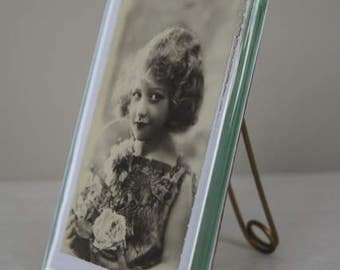 Art Deco picture frame with ball ground glass edges.