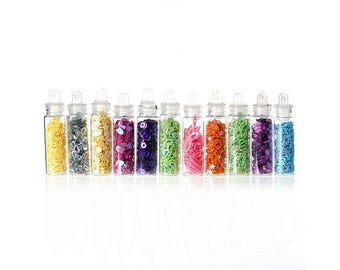 12 mini jars of glitter to forms