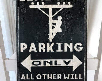 Lineman parking, all others will be powerless wooden sign