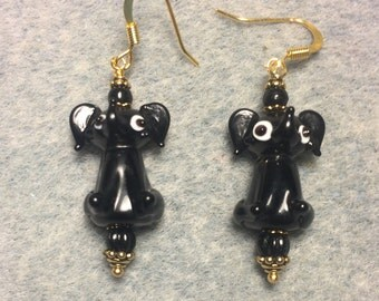Opaque black lampwork sitting elephant bead earrings adorned with black Czech glass beads.