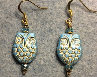 Light aqua with gold wash Czech glass owl bead earrings adorned with light aqua Chinese crystal beads.