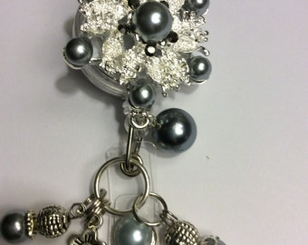 Silvertone and gray faux pearl Retractable badge holder