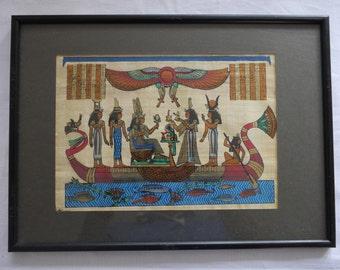 Egyptian artwork on papyrus, glass frame