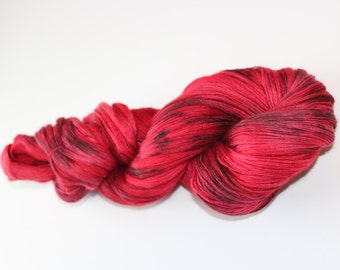 Hand dyed merino and silk lace weight yarn; Color: Spattered