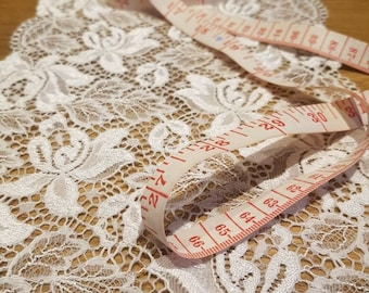 Stunning vintage lace trim wide lace double edged trim slight elasticity 7 inches wide x 23 inches length . White lace. Made in France