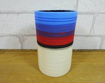 Small Blue vessel with Black glaze inside.
