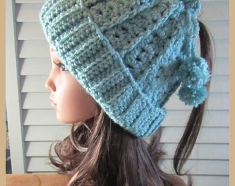 Soft Green Crocheted Hat with Drawstring and Pom-poms . .