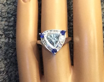 14K white gold aquamarine ring with sapphires and diamonds.  Size 7.