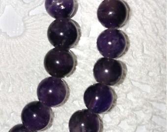Amethyst beads 7 - 8mm / 19 1/2 inch strand
