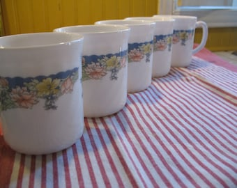 Vintage 5 beautiful cups coffee or tea twisted arcopal france pretty pink, yellow flower on a blue background.
