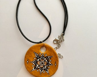 Handmade and decorated circle necklace with pattern detail