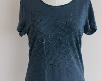 Hand-dyed blue T-shirt with geometric pattern